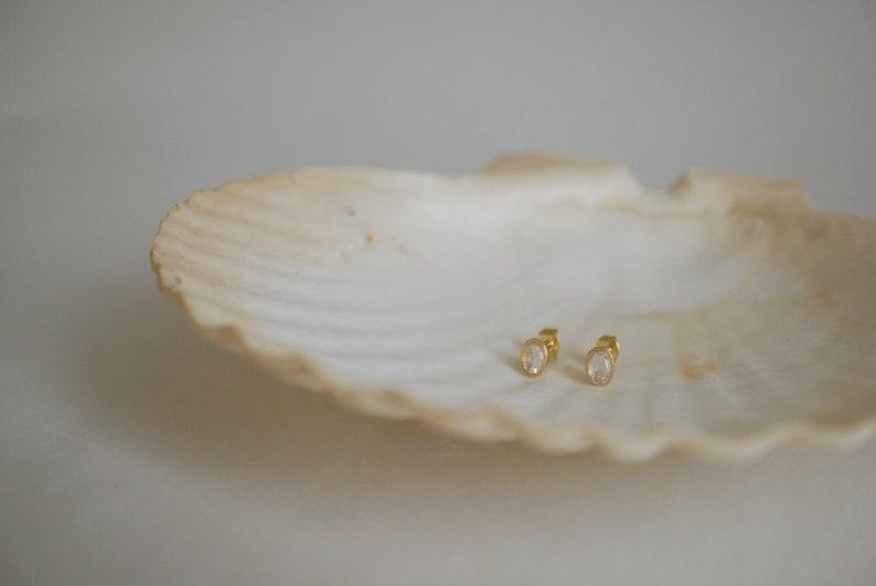 Beautiful moonstone stud earrings by FoeandDear on Etsy.