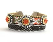 Friendship bracelet cuff in khaki and coral embellished with studs together with snake print leather and rhinestones - bohemian hippie style