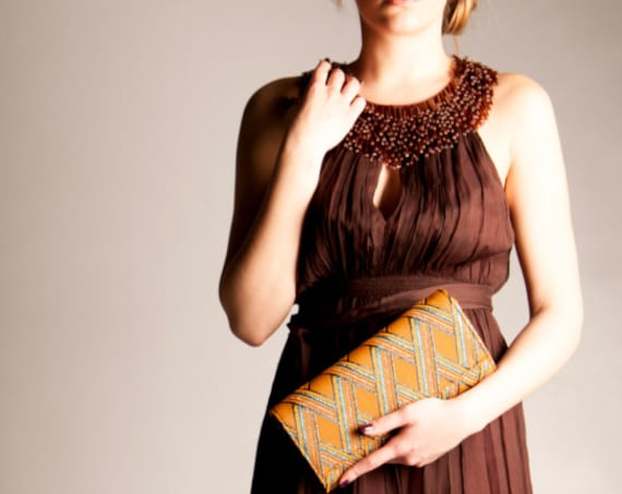 orange and teal geometric pattern design clutch bag crossbody metallic flap front purse