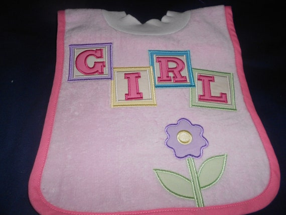 Girl over the head bib with flower