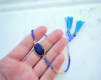 Lapis Lazuli beaded bracelet - gold, blue tussles bracelet