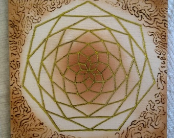 Penrose pattern tiling inspired graphic art - pyrographic art and airbrushing on wood plaque