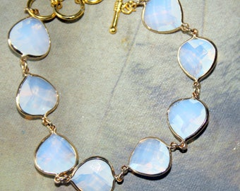 Milky White Tear Drop Shaped Glass Crystal Beads with Gold Links Bracelet