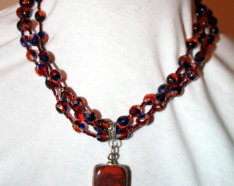 Red Jasper Pendant with Red and Blue Venetian Glass Faceted Beads