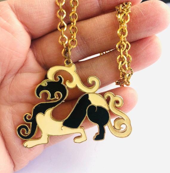 JJ 1988 Round Gold Tone Oriental Design Pendant Necklace