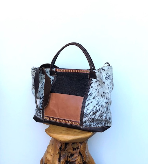 Large brown hair-on cowhide and kilim textile tote or travel bag with leather straps and trim