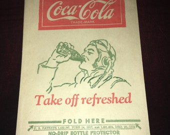 Vintage Coca Cola Dry Server Bottle Drip Protector Sleeve featuring Airplane Pilot