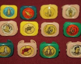 Lot of 12 Vintage 1951 Kellogg's Space Rings; PEP Cereal Box Premiums, Rocketship, Tom Corbett Space Cadet, Rocket, Ray Gun
