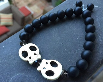 SALE!  Unisex double headed Skull beads made of bone Bracelet with Smokey Quartz and Black Onyx accent beads on a clear stretch cord!