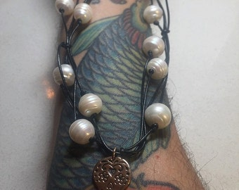 SALE!! Unisex Black Leather Necklace with Hand Knotted Freshwater Pearls and a Bronze Skull Charm.