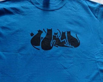 Clowder: group of cats, glaring Tee size L