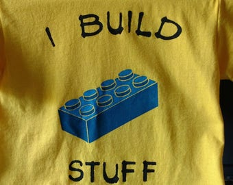 Bright yellow tee with blue brick, size kids small (6-8)