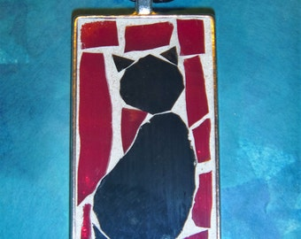 Black cat mosaic pendant with red background