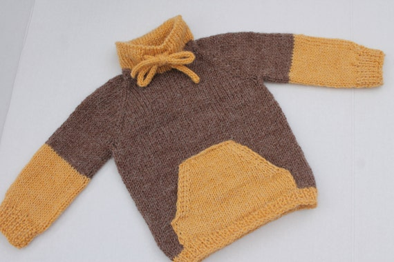 c0e178bafbe1 Hand Knit Baby Boy Pullover with Kangaroo Pockets. Brown