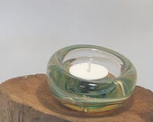 Blown glass candle holder, ornate clear glass a swirl of green with a hint of yellow