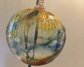 Blown glass Tidal ball aka floats, witches or friendship balls.  Individually handmade for hanging inside or out during the warmer months!