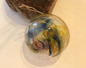 Blown glass ball, float witches, friendship or tidal ball. Handmade, swirl of light colours including orange, yellow , blue and clear