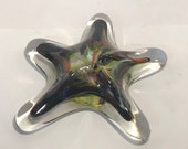 Army Greens Blown Glass Sea Star. This organic shape is handmade and can hang adding sparkle and shine to your beach home decor!