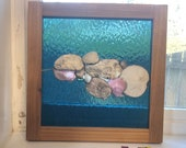 Original TideLine.  A series of traditional stained glass that incorporates found items from our local beach and framed in custom cedar!