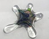 Rainbow coloured Blown Glass Sea Star. This organic shape is handmade adding sparkle n' shine to your beach home decor!