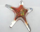 Bright Orange Blown Glass Sea Star. This organic shape is handmade adding sparkle n' shine to your beach home decor!