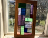Traditional Stained Glass Abstract Window.  Framed in custom cedar, bright in colours offers privacy and a fun sun catcher!