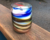 Blown glass rainbow soy candle holder.  Custom made one of a kind with a wooden wick to accentuate any room in the house!