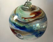 Blown glass ball, float witches, friendship or tidal ball. Handmade, swirl of colours including Blues & Oranges
