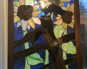 Large sun flower and crow stained glass picture window.  Antique glass used in this unique sun catcher stained glass panel cobalt blue sky