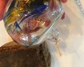 Blown glass Tidal ball aka floats, witches, or friendship balls.  Handmade individually for hanging inside or out during the warmer months!