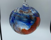 Blown glass ball, float witches, friendship or tidal ball. Handmade, swirl of colours including orange, yellow, blue and clear