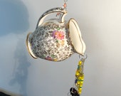 Refurbished, up cycled Creamer Garden hanging! This sweet little gem is riddled with Swarovski crystals to sparkle and shine on your patio!
