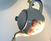 Refurbished, up cycled Tea Pot Garden hanging! This sweet little gem is riddled with Swarovski crystals to sparkle and shine on your patio!