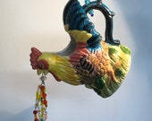 Refurbished, up cycled Tea Pot Rooster Garden hanging! This sweet little gem is riddled with Swarovski crystals to sparkle & shine outside!