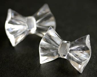 Two (2) Clear Bow Buttons. Clear Buttons. Bow Tie Buttons. Clear Buttons. Clear Acrylic Buttons. Clear Plastic Buttons. 19mm x 25mm