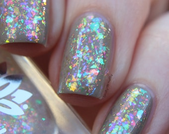 """Nail polish - """"Cohesion"""" A clear based topper filled with four different iridescent shifting flakes."""