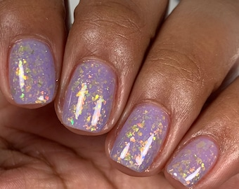 """Nail polish - """"Feels Pretty Real"""" A pale purple base with copper / gold / green shifting iridescent flakes."""