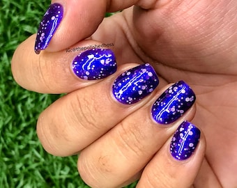 """Nail polish - """"Cast Astray"""" A purple base with strong blue / purple aurora shimmer and white glitter"""