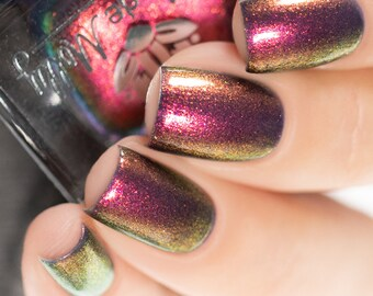 "Nail polish - ""Beyond Repair"" A navy blue base with a pink / orange / gold / green shifting aurora shimmer."