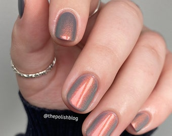 "Nail polish - ""Short Term"" A grey crelly base with copper / gold / green shifting aurora shimmer."