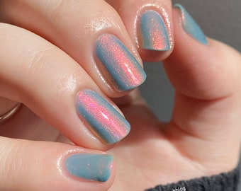 """Nail polish - """"Cloud My Vision"""" A pale dusty blue with a pink / orange / gold / green shifting shimmer."""