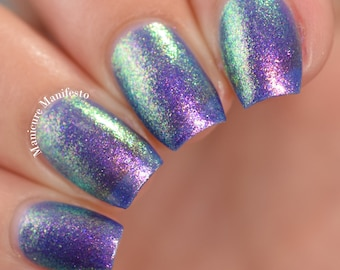 """Nail polish - """"Open Work"""" A purple base with pink / gold / green shifting aurora shimmer."""