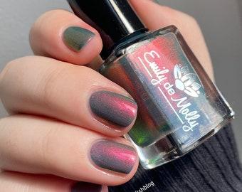 "Nail polish - ""Such A Farse"" A green base with pink / orange / gold / green shifting aurora shimmer."
