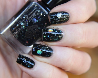 """Nail polish - """"Dark Forces 2.0"""" holographic silver dot glitter in a black base"""