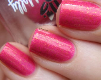 "Nail polish - ""Embellished Response""  A bright pink with gold shimmer and gold flakes."