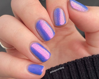 """Nail polish - """"It's Never Enough"""" A bright cornflower blue with a strong pink / copper / gold / green shifting shimmer"""