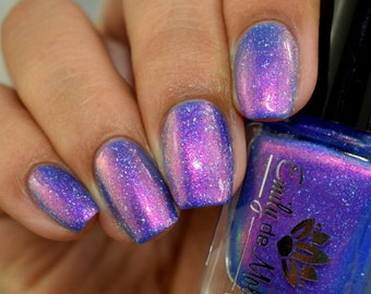 """Nail polish - """"Here We Go Again"""" A bright blue with aurora shimmer and holographic flakes."""