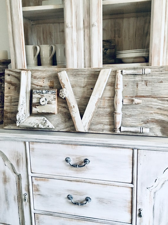 Gorgeous handmade rustic luxe wood LOVE sign by Burlapluxe is a gorgeous example of Nordic French style that could work in a variety of settings.
