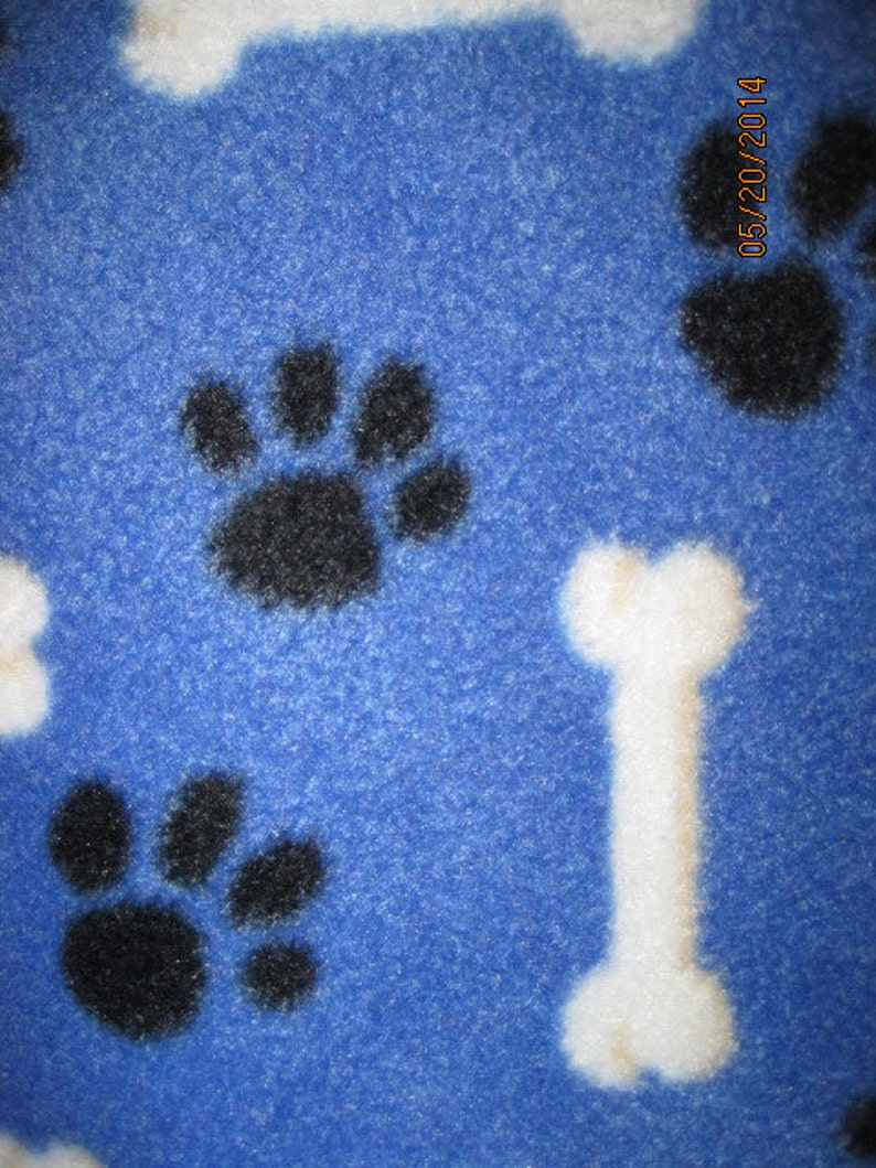 Paw Prints on Blue with Black Fleece Blanket This Blanket is READY to Ship NOW