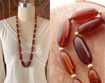 """vintage Amber Lucite Necklace 1960s Mid Century Modern 31.5"""" long beaded necklace smooth polished graduated beads"""